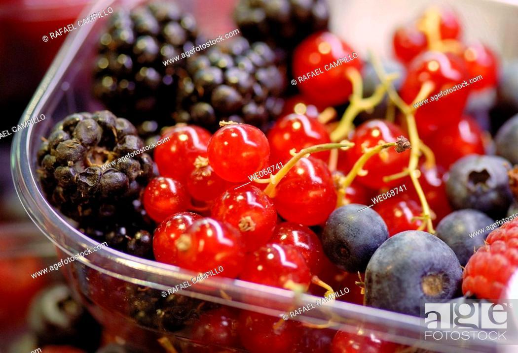 Stock Photo: Berries for sale at La Boqueria market, Barcelona. Catalonia, Spain.