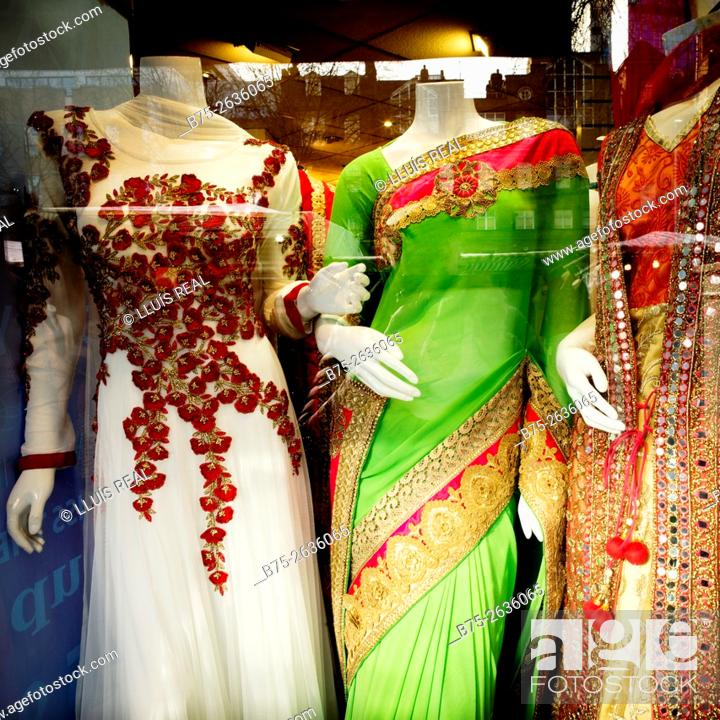Stock Photo: Closeup of an indian fashion shop window in Whitechapel Road Market. Whitechapel, Tower Hamlets, East London, London, England, UK.
