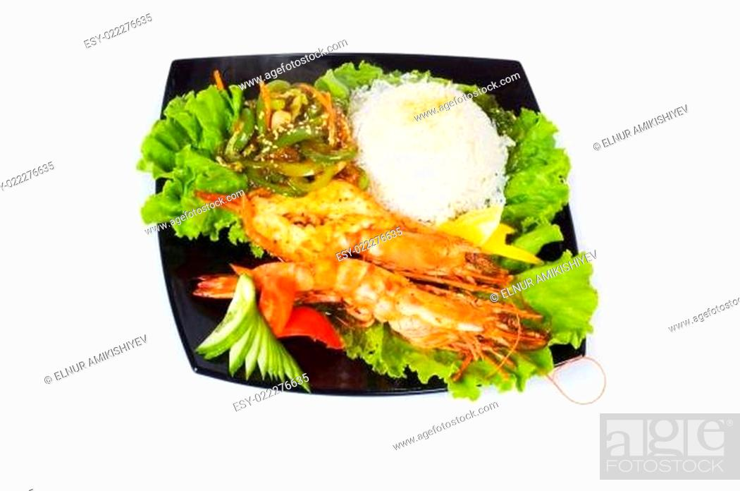Stock Photo: Grilled lobster, rice and vegetables isolated on white.