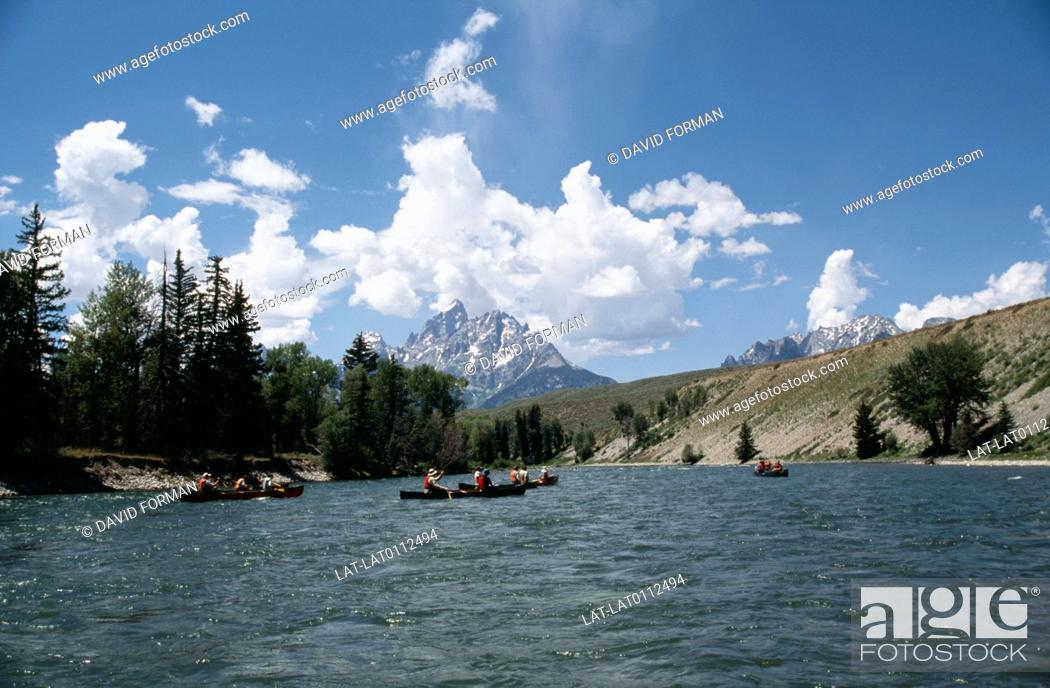 Stock Photo: Grand Teton National Park is named after Grand Teton the largest mountain in the Teton Range at 13, 770 feet. The Teton Range is part of the Rocky Mountains.