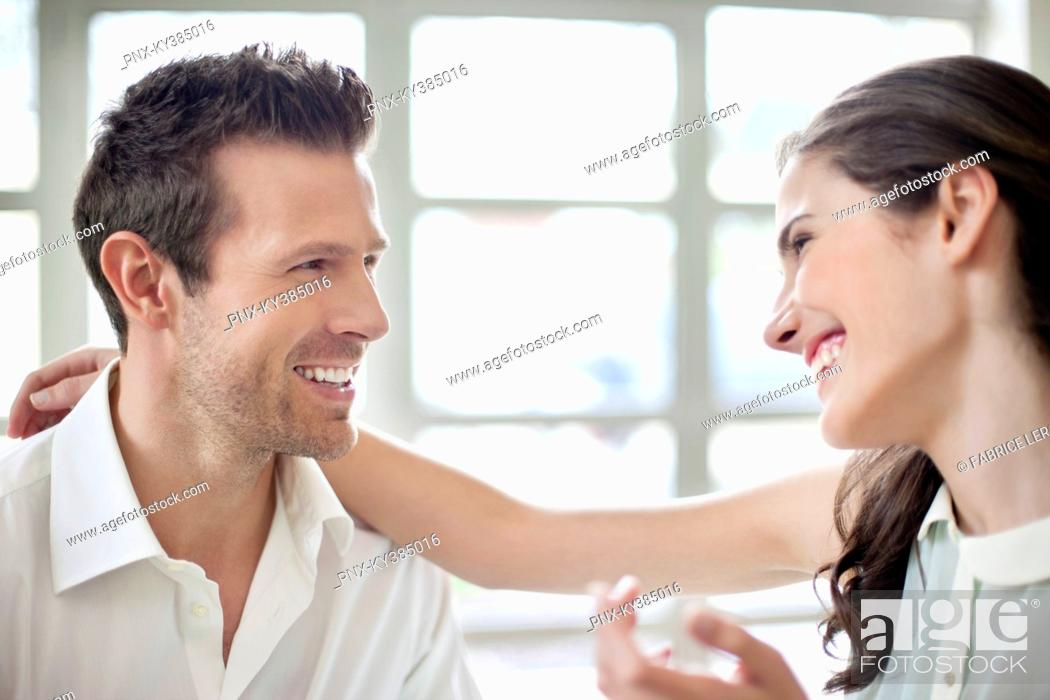 Stock Photo: Close-up of a couple smiling.
