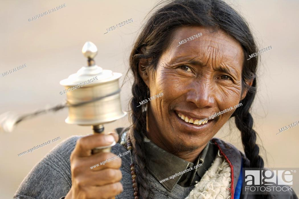 Stock Photo: A tibetan man look in camera and play the pray wheel  Ngari Prefecture  Tibet province  China  Asia.