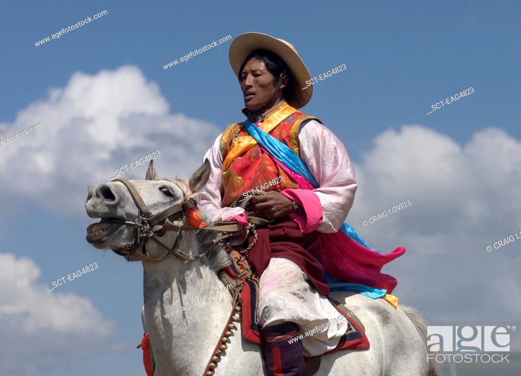 Stock Photo: Khampas, the warrior horseman of old Tibet, compete at the Litang Horse Festival - Kham, Sichuan Province, China, Tibet.