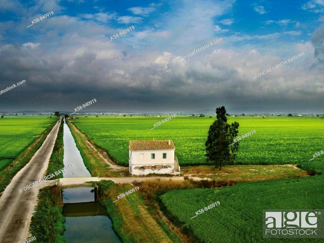 Stock Photo: Aerial view of rice paddies and Cottage in the Ebro Delta, Catalonia, Spain.