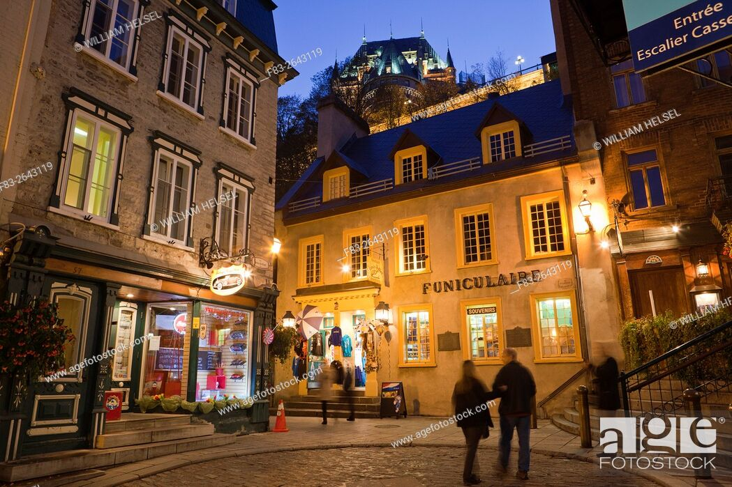 """Stock Photo: Old Town Quebec City, """"""""Vieux-Quebec"""""""", Canada: Shops and entrance to cable car, """"""""Funiculaire"""""""", to upper town and Chateau Frontenac, dusk."""