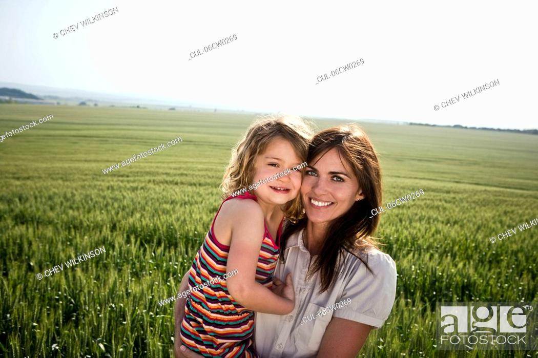 Stock Photo: Woman and child in wheat-field.