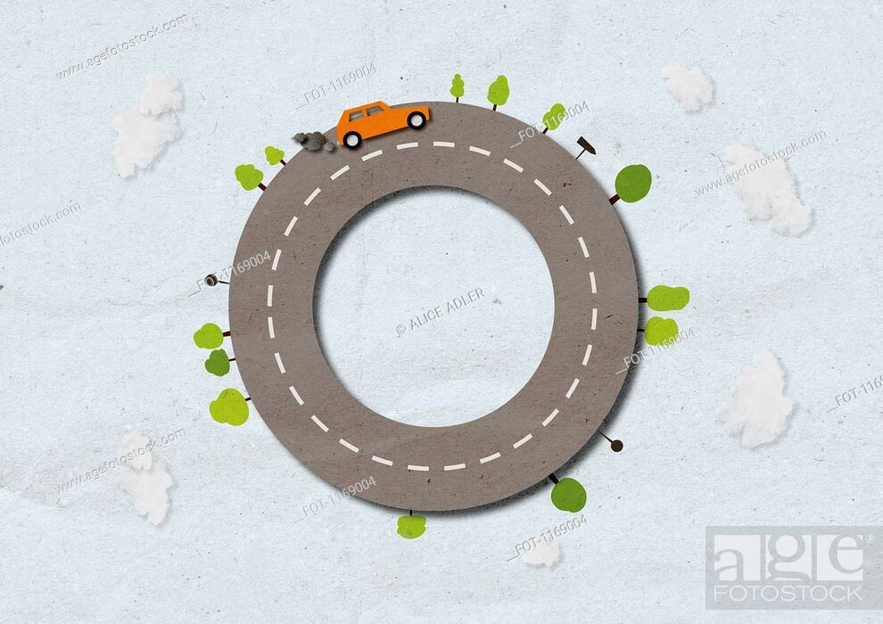 Stock Photo: A car with smoke coming from exhaust driving on street shaped like a circle.
