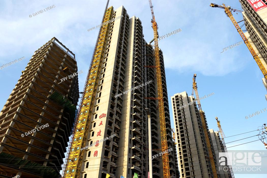 Stock Photo: City of Taiyuan, Shanxi, China. New and under construction apartment blocks high rise accommodation, some are private sector property ventures.