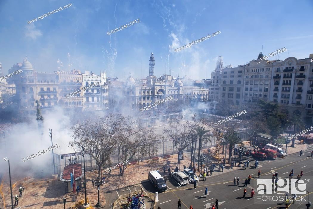 Stock Photo: Mascleta firecrakers at the Town Hall of Valencia during the Fallas Festival in Spain.