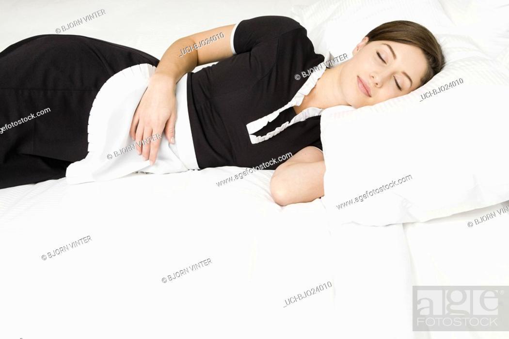 Stock Photo: Maid sleeping on bed.