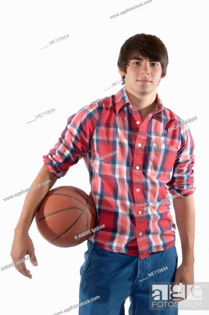 Stock Photo: Male teenager with basketball.