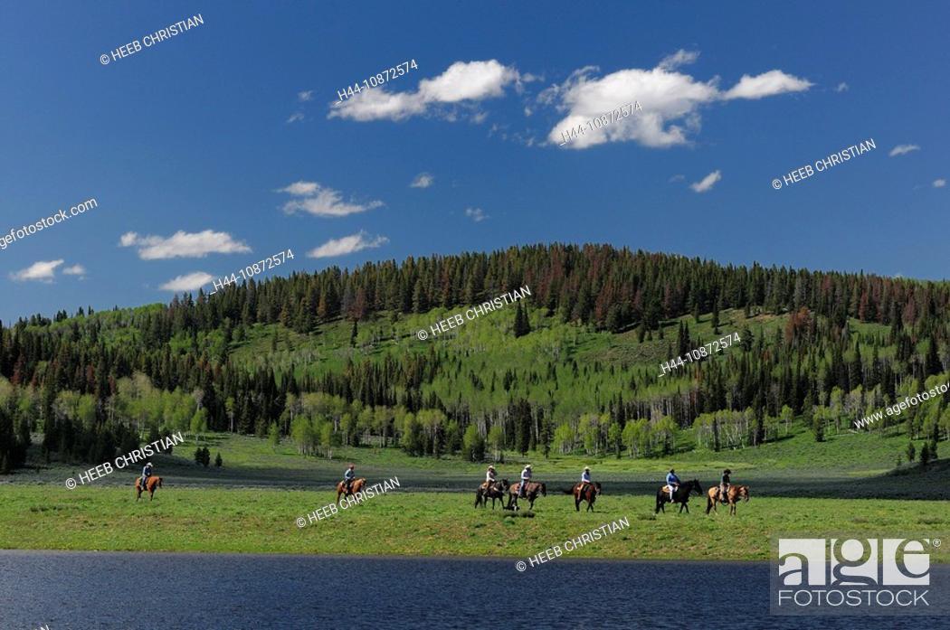 Stock Photo: Horseback riders at Lake, Flying A Ranch, Pinedale, Wyoming, USA.