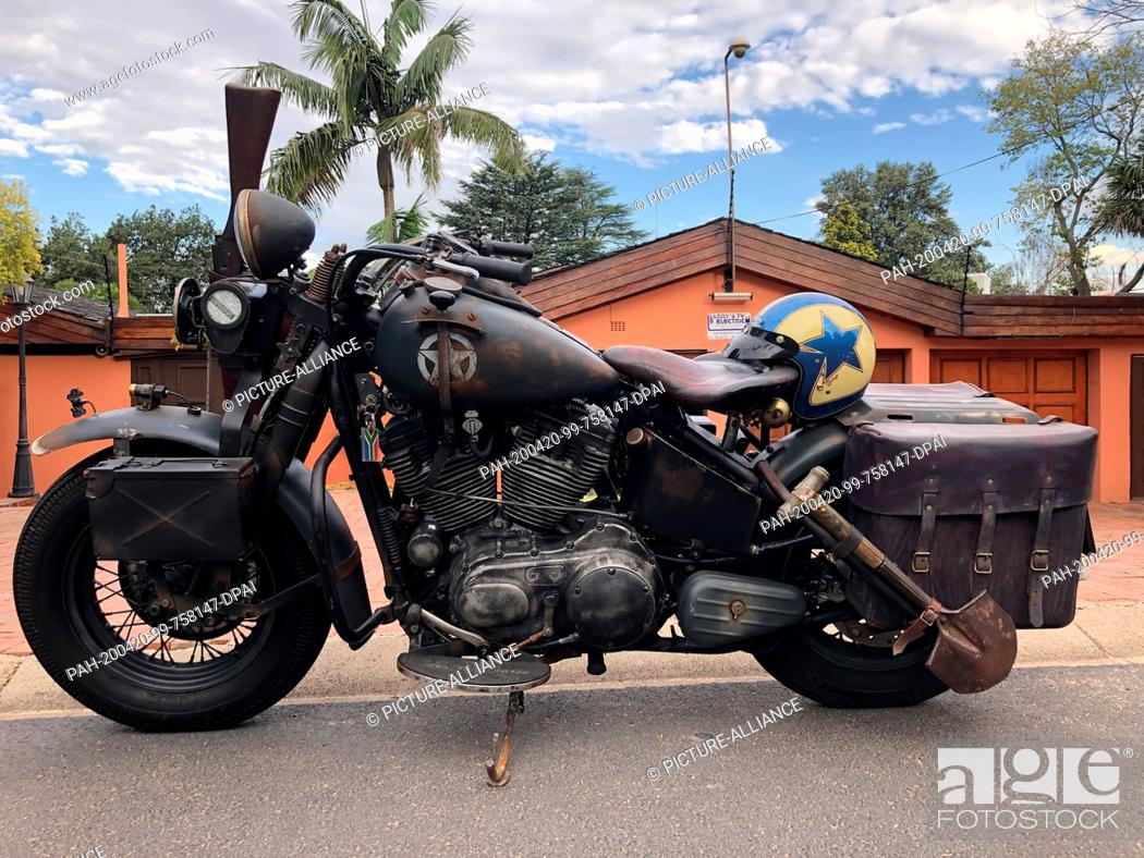 Stock Photo: 08 March 2020, South Africa, Johannesburg: Eye-catchers like this Harley-Davidson are no rarity in front of the garage of South African oldie fan L.