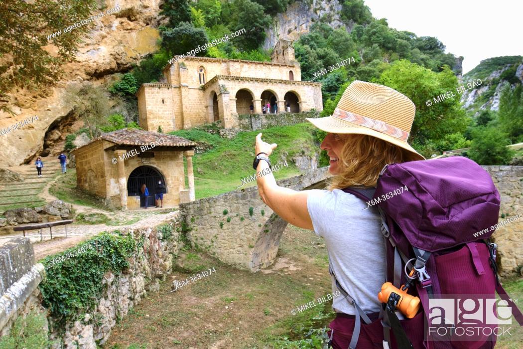 Stock Photo: Hiker mature young woman in Santa Maria de la Hoz chapel. Tobera, Frias town, Burgos, Castile and Leon, Spain.