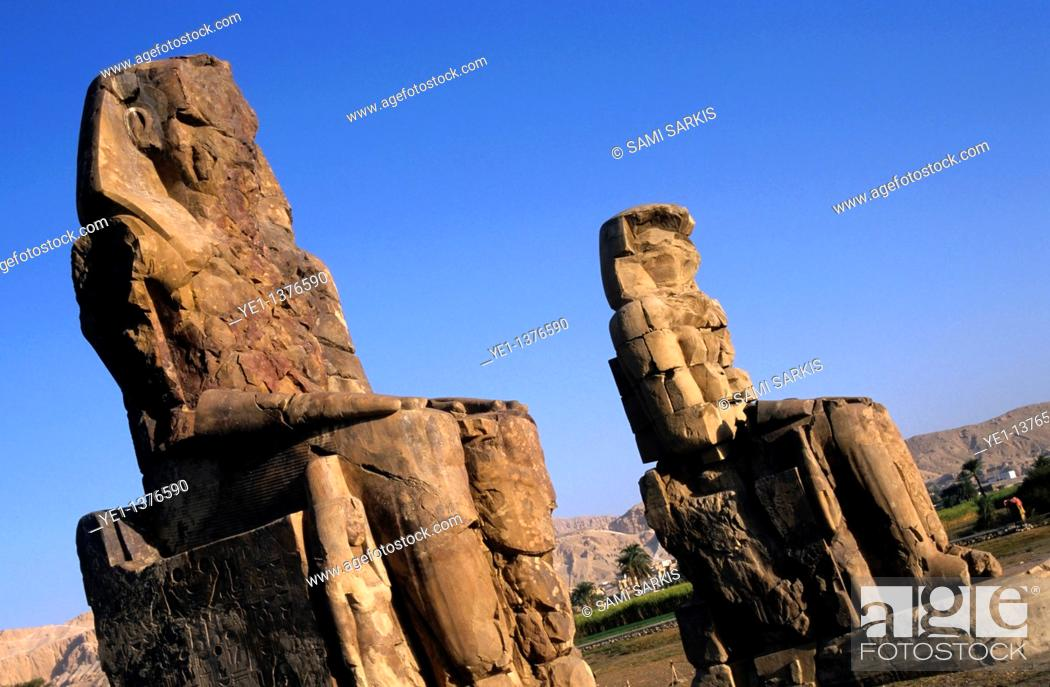 Stock Photo: The Colossi of Memnon, two massive stone statues of Pharaoh Amenhotep III, in the Theban necropolis, Luxor, Egypt.
