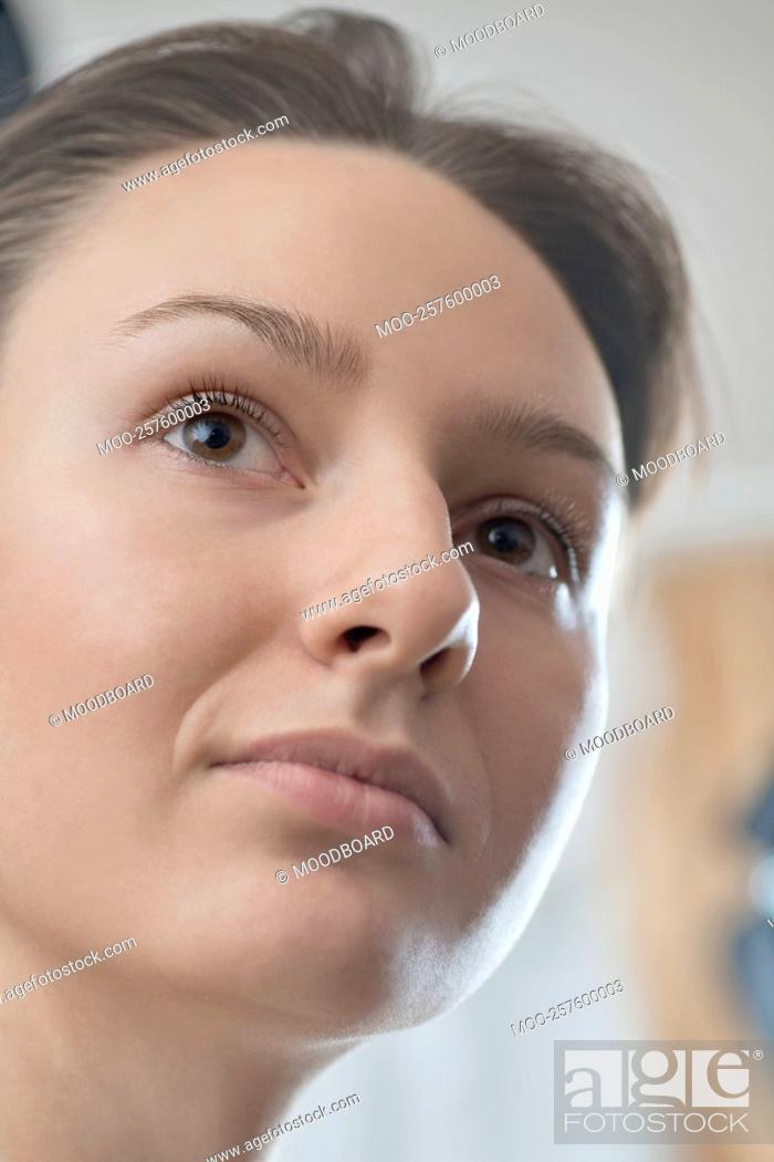 Stock Photo: A close up of a young womans face.