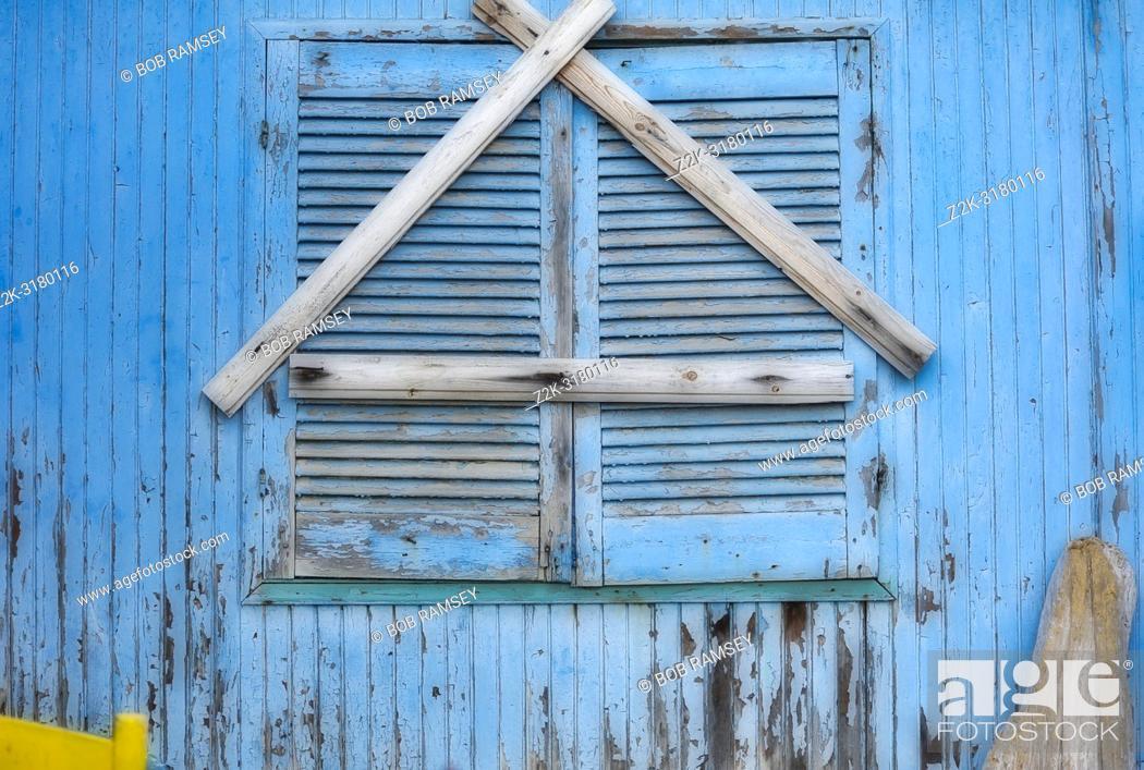 Stock Photo: Wooden blueshutters. Loutro, Crete, Greece.