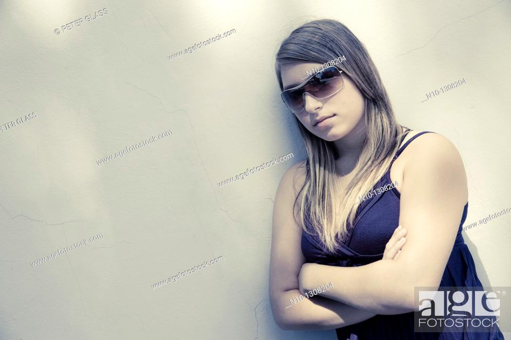 Stock Photo: Teen girl wearing sunglasses.