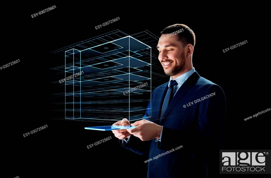 Stock Photo: business, people and future technology concept - smiling businessman in suit working with transparent tablet pc computer and virtual construction hologram over.
