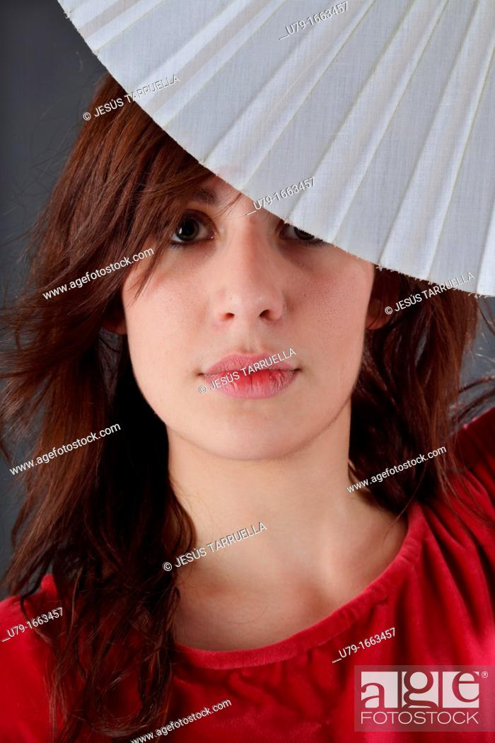 Stock Photo: Woman with fan.