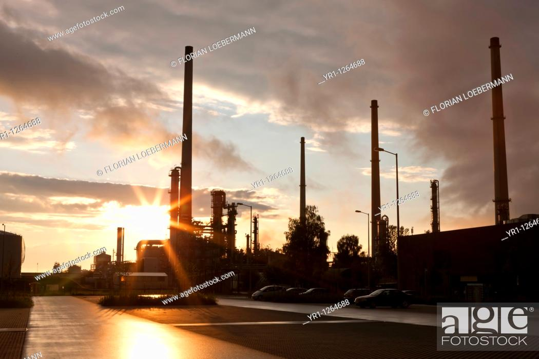 Stock Photo: Sunset over an oil refinery in southern germany.