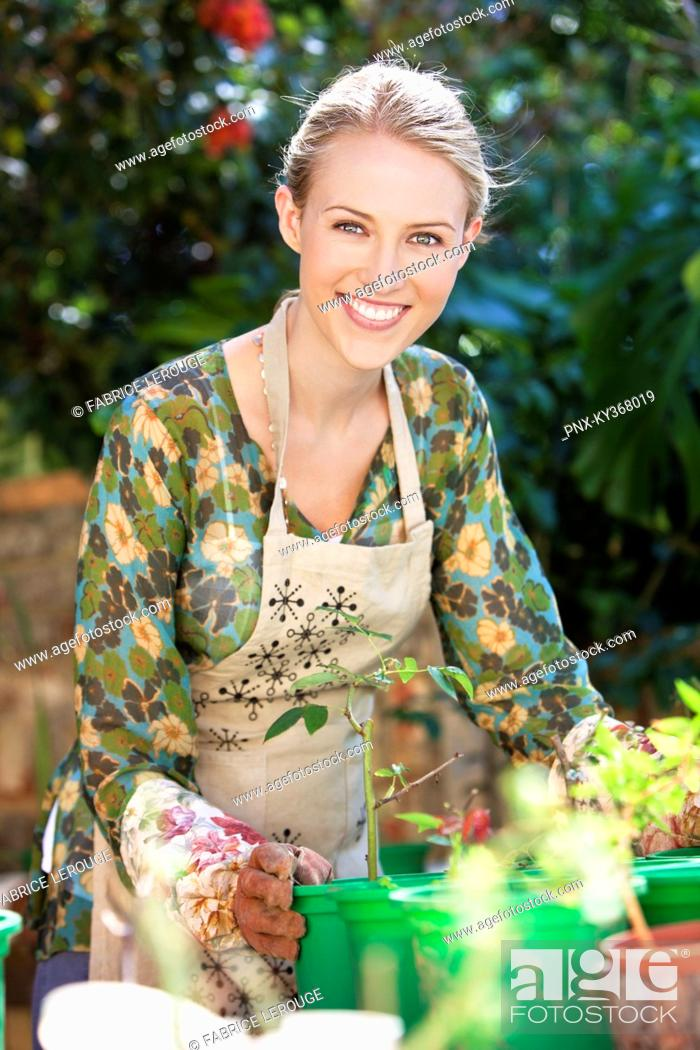 Stock Photo: Portrait of a woman gardening and smiling.