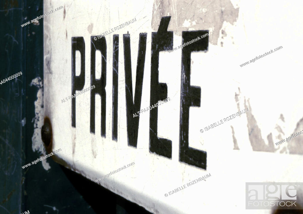 Stock Photo: 'Private' text in French, close-up.