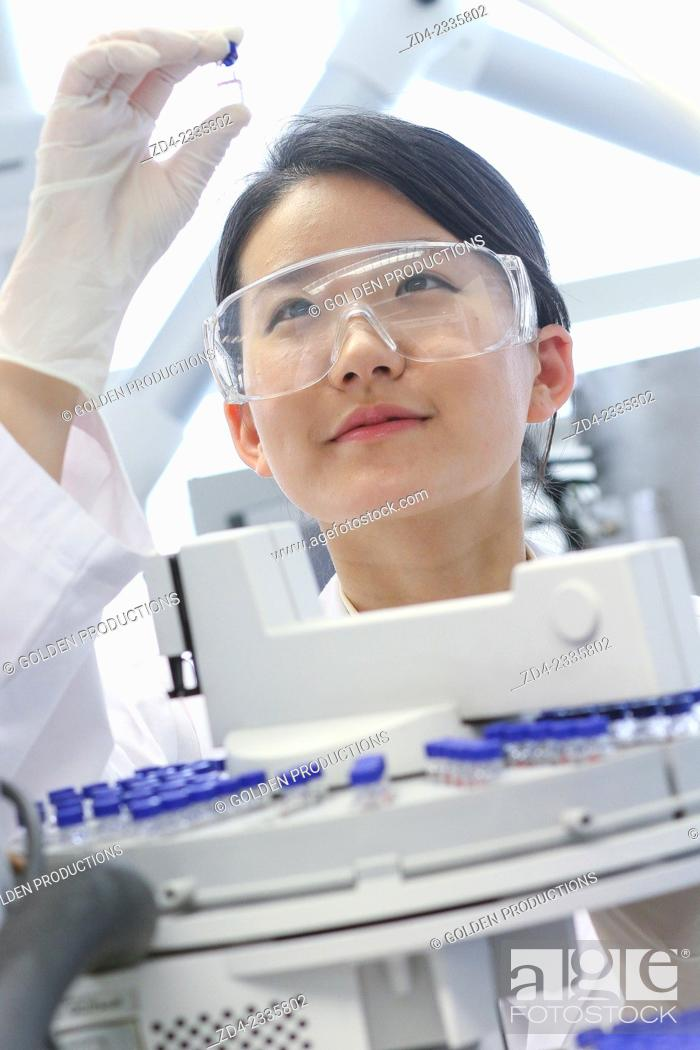 Stock Photo: Researcher. GC / MS. Gas chromatograph with mass detector. Analysis of organic compounds in extracts obtained sample pretreatment. Organic Laboratory.