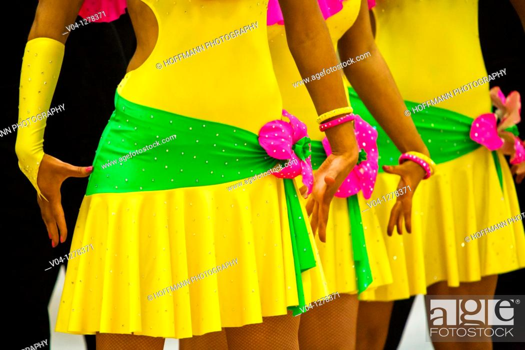 Stock Photo: Colorful pattern of female dancers at a dance contest.