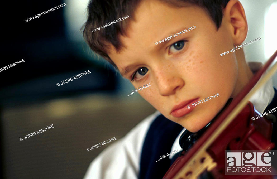 Stock Photo: A boy, 5-10 years old, playing a violin.
