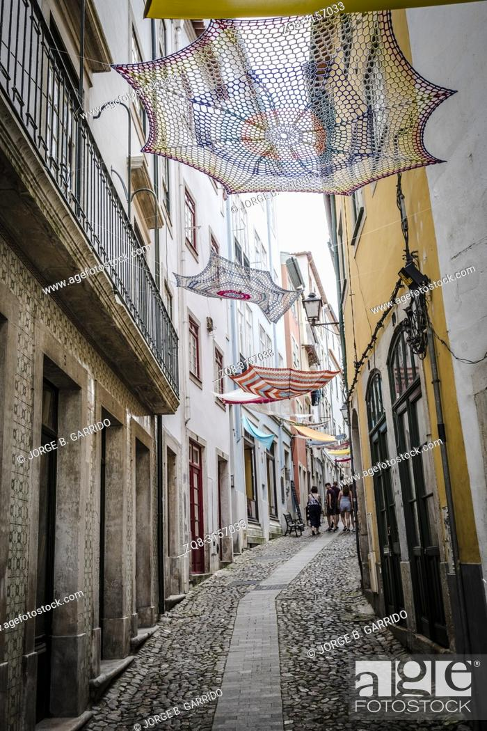 Stock Photo: People wlaking at the streets of Coimbra, Portugal.