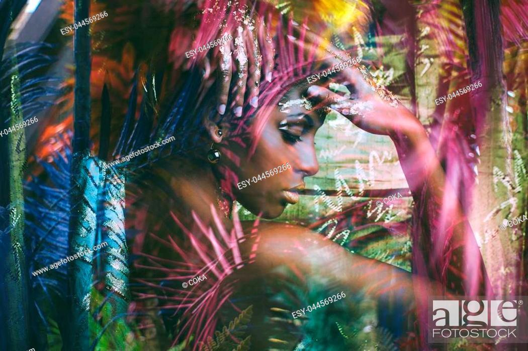 Stock Photo: young black woman fantasy portrait profile double exposure.