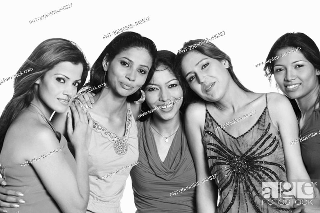 Stock Photo: Portrait of five young women standing together and smiling.
