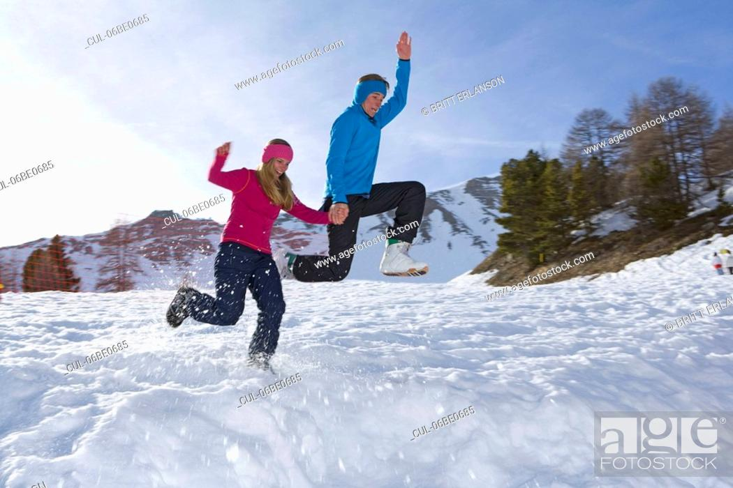 Stock Photo: Couple at ski, jumping.