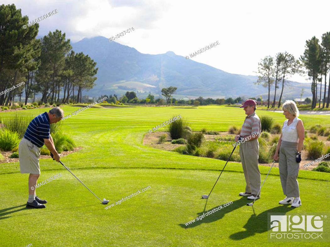 Stock Photo: Friends playing golf.