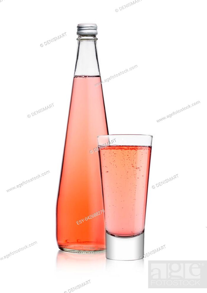 Stock Photo: Bottle and glass of sparkling pink soda drink lemonade on white background.
