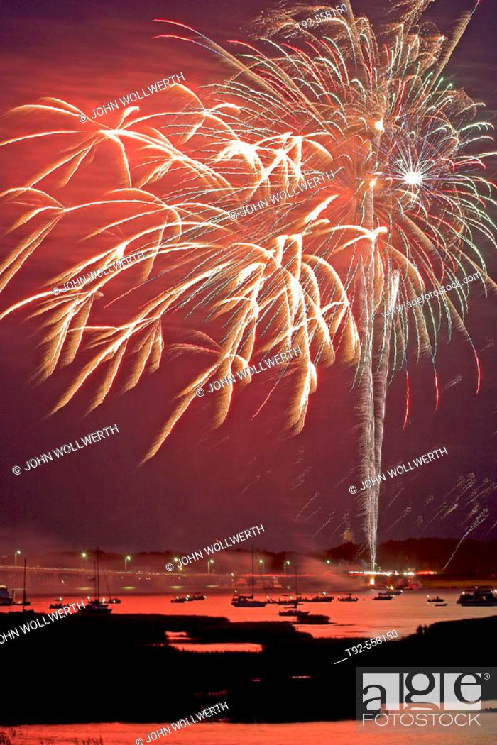Stock Photo: Fireworks reflecting on the water, Beaufort. South Carolina. USA.