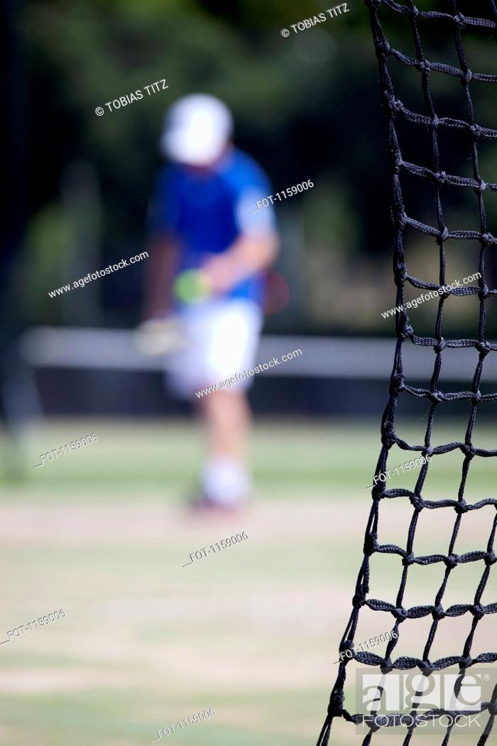 Stock Photo: Tennis net and player.