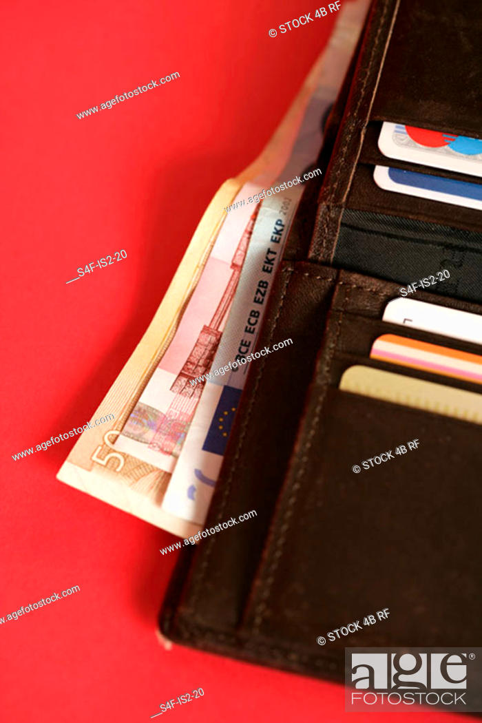 Stock Photo: Purse with credit cards and bills (part of), close-up.
