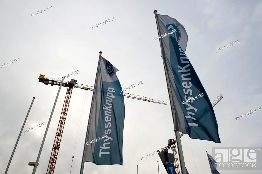 Flags with the company logo outside of the ThyssenKrupp Elevator