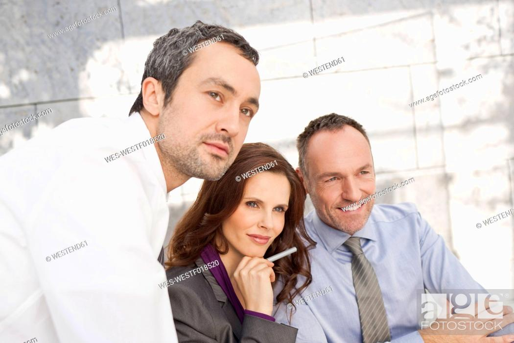 Stock Photo: Germany, Leipzig, Business people looking away.