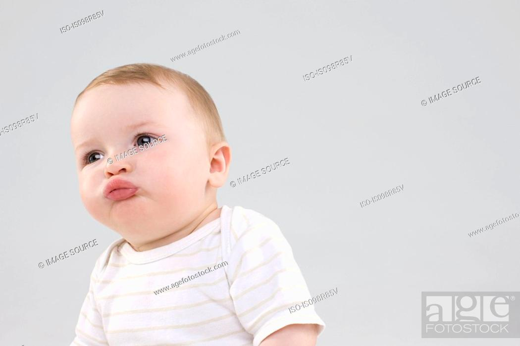 Stock Photo: Baby making faces.