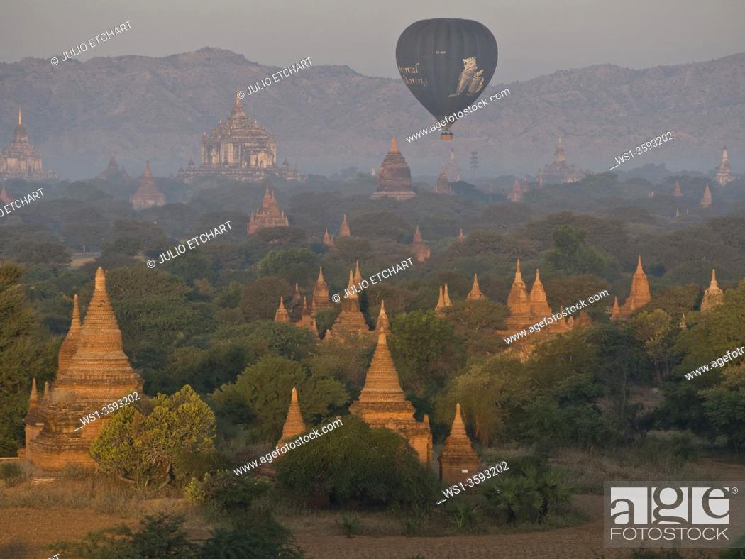 Stock Photo: Balloons taking tourists at sunrise in the Buddhist temples of Bagan, Myanmar.