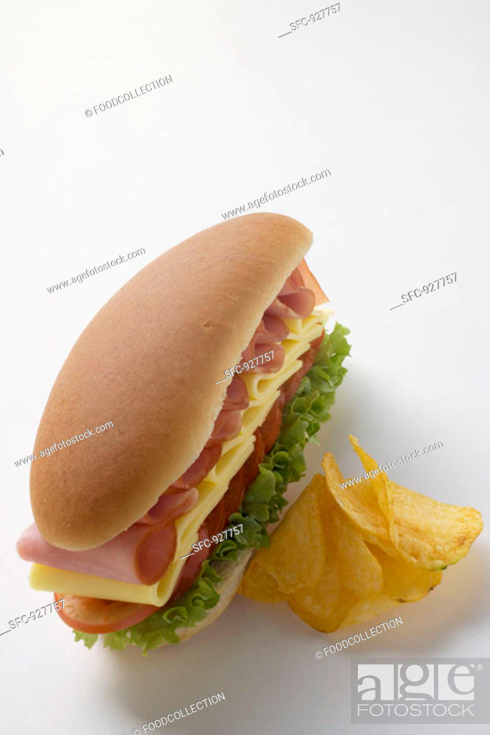 Stock Photo: Ham, cheese, tomato and lettuce sandwich with crisps.