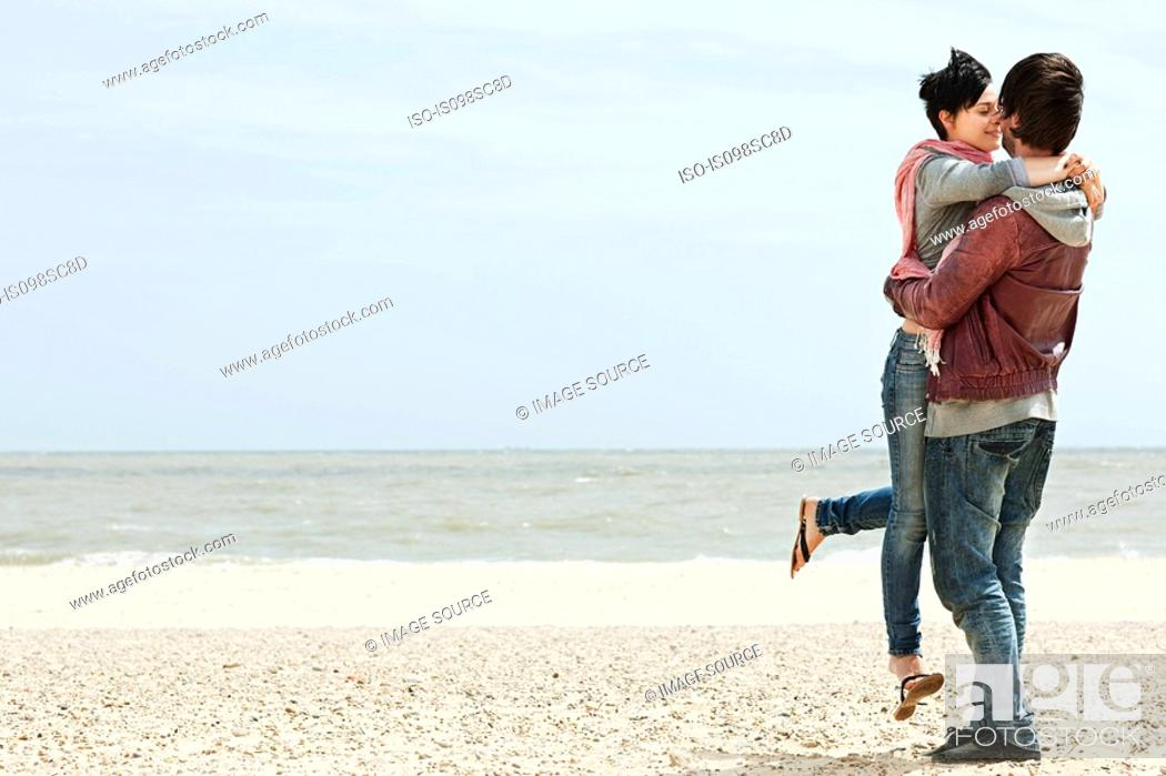 Stock Photo: Young couple by the sea.