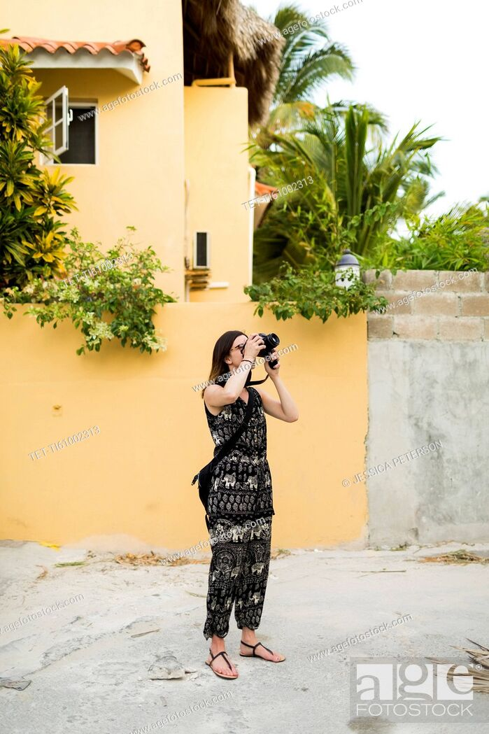 Stock Photo: Woman taking photos during vacations.
