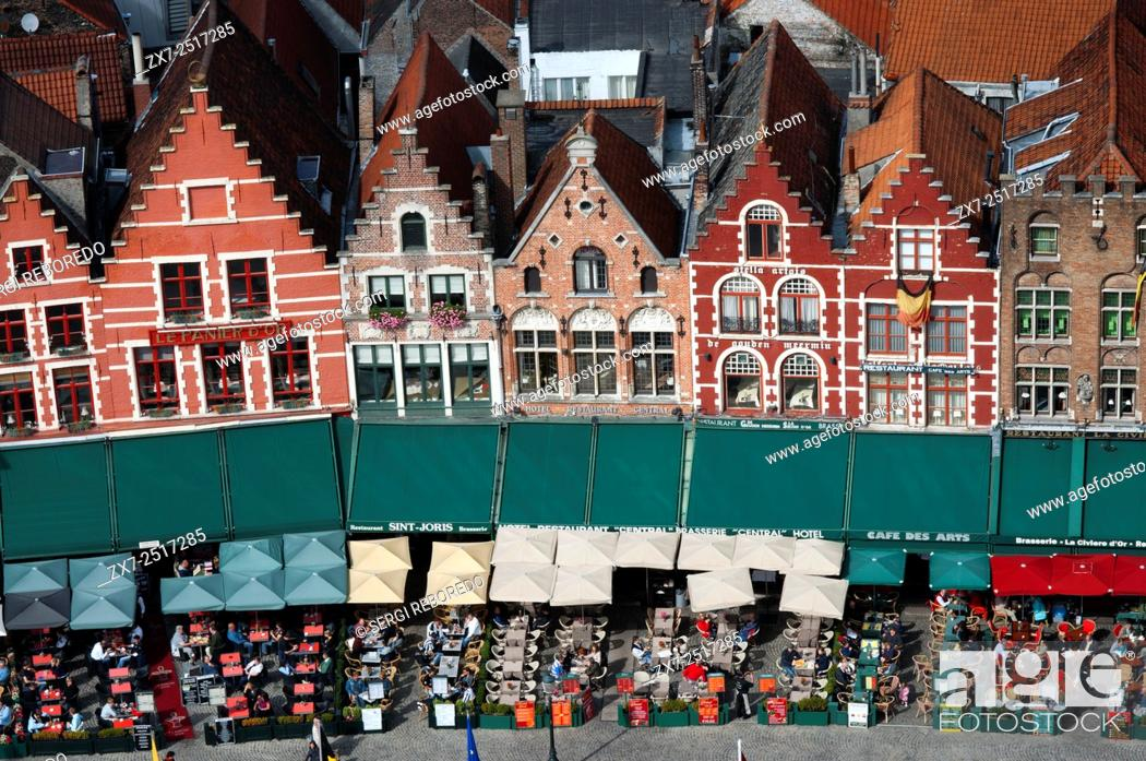 Stock Photo: Row of ornate historic buildings in Market Square in Bruges in Belgium. On the Southern side of the Market several medieval-looking houses can be seen.