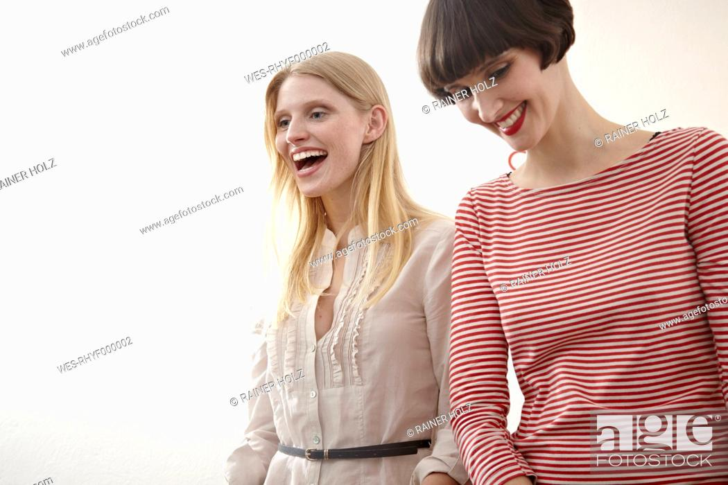 Stock Photo: Germany, Cologne, Young women having fun, smiling.