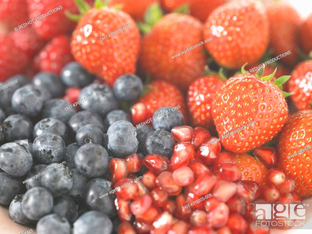 Stock Photo: Blueberries raspberries strawberries and Pomegranate seed.