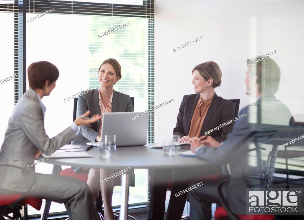 Stock Photo: Business people meeting at table in conference room.